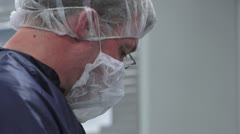 Closeup of Technicians Face in Cleanroom - stock footage
