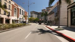 POV RODEO DRIVE TO BEVERLY WILSHIRE HOTEL Stock Footage