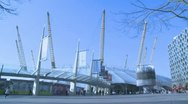 Crowds walk past O2 in London Stock Footage