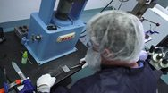 Technician working with tools in cleanroom Stock Footage