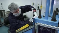 Front Angle of Technician working in cleanroom - stock footage