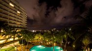 Stock Video Footage of Luxury Hotel with swimming pool at night, TImelapse