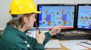 Stock Video Footage of Industrial worker in control room