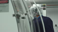 Technician working at Machine in Clean Room Stock Footage
