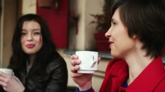 Female friends chatting and drinking coffee in outdoor cafe, steadicam shot HD Stock Footage