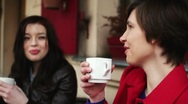 Stock Video Footage of Female friends chatting and drinking coffee in outdoor cafe, steadicam shot HD