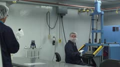 Technicians in cleanroom have a disagreement - stock footage