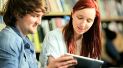 Smiling classmates learning exams in information hub  - stock footage