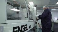 Technician Closes machine door in cleanroom Stock Footage