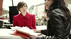 Two female friends chatting in restaurant, steadicam shot HD Stock Footage