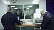 Stock Video Footage of Technicians preparing to work in Cleanroom