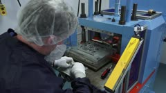Technician Works Molding Machine in Cleanroom - stock footage