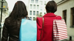 Women with shopping bags walking in the city, steadicam shot HD Stock Footage