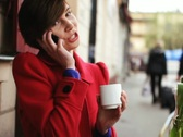 Attractive woman talking on cellphone in cafe, steadicam shot NTSC Stock Footage