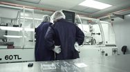 Stock Video Footage of Two Technicians work together in Cleanroom