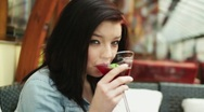 Happy young woman drinking cocktail in bar, steadicam shot HD Stock Footage