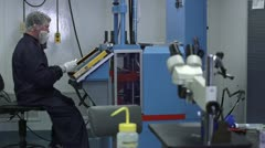 Man Working with Machine in Cleanroom - stock footage