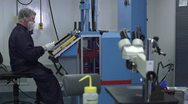 Man Working with Machine in Cleanroom Stock Footage