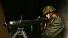 Soldier aiming with machinegun Stock Footage