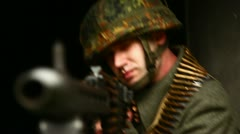 Soldier aiming with machinegun closeup Stock Footage