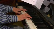 Close up of hands playing the piano Stock Footage