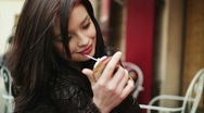 Beautiful woman applying beauty make-up in the city, steadicam shot HD Stock Footage