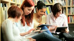Diverse friends study online education in hub  Stock Footage