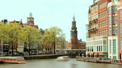 Timelapse, Typical house Fronts, Canal and old clock and bell tower of Amsterdam Stock Footage