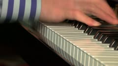 Extreme close up of hands playing the piano - 3/4 view Stock Footage