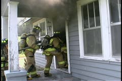 Firefighter entry into a house Stock Footage