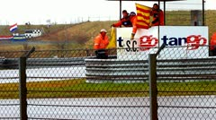 Waving Flag on Racetrack in Zandvoort and holding S.C. sign, Netherlands Stock Footage