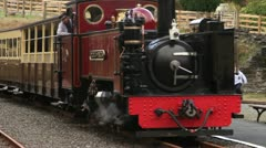 Narrow gauge railway arriving at station Stock Footage