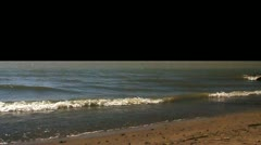 Waves rolling in on the beach - Alpha channel - stock footage