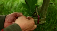 Soldier is setting up a trap with a grenade close - stock footage