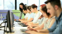 University  teacher learning students online on computers   Stock Footage