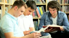 Young classmates working exam   Stock Footage