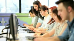 Group of classmates follow tutor instructions in class  - stock footage