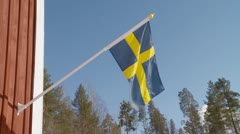 Swedish flag blue sky Stock Footage
