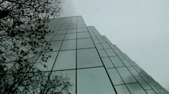 Commercial glass mirror building reflections cload timelapse city scape busines  Stock Footage
