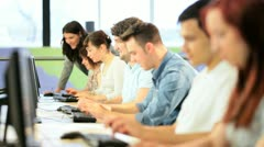 Male and female follow instructions tutor in IT room  - stock footage