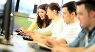 Lecturer and college students working on IT application   Stock Footage