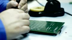 Government worker soldering Stock Footage