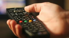 Changing the channel on the TV Stock Footage