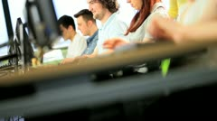 Diverse classmates and lecturer working with online technology   - stock footage