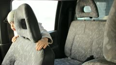 The child in the car, equipped with child seat Stock Footage