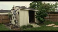 Taking down a shed Stock Footage