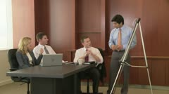 Young business man making presentation to coworkers Stock Footage