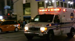 Ambulance 911 car emergency at night New York City medical health hospital Stock Footage