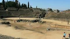 Spain Merida Roman amphitheater with tourists Stock Footage