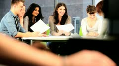 Lecturer teaching class of graduate students   - stock footage